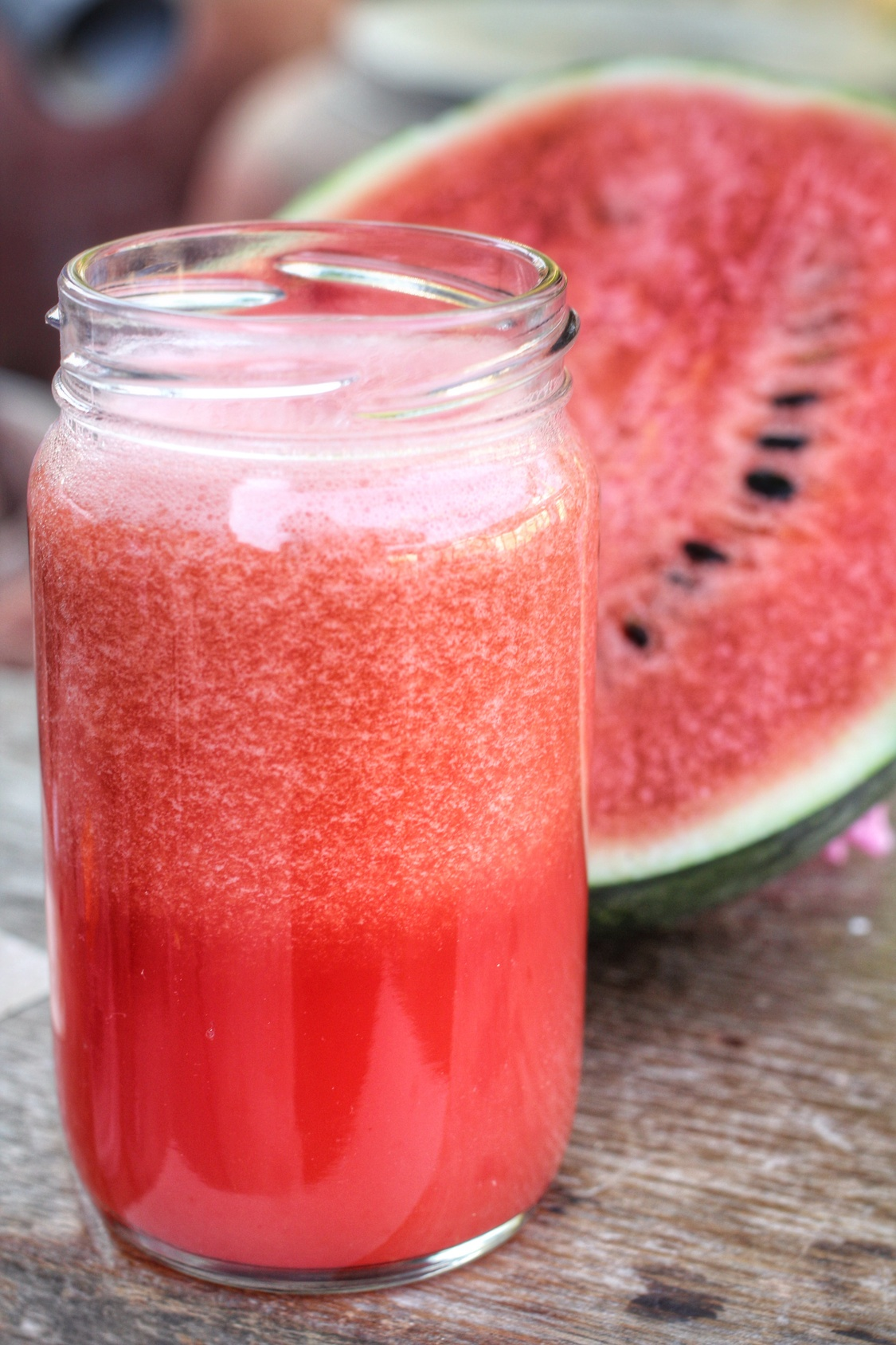 watermelon smoothies on the wood background