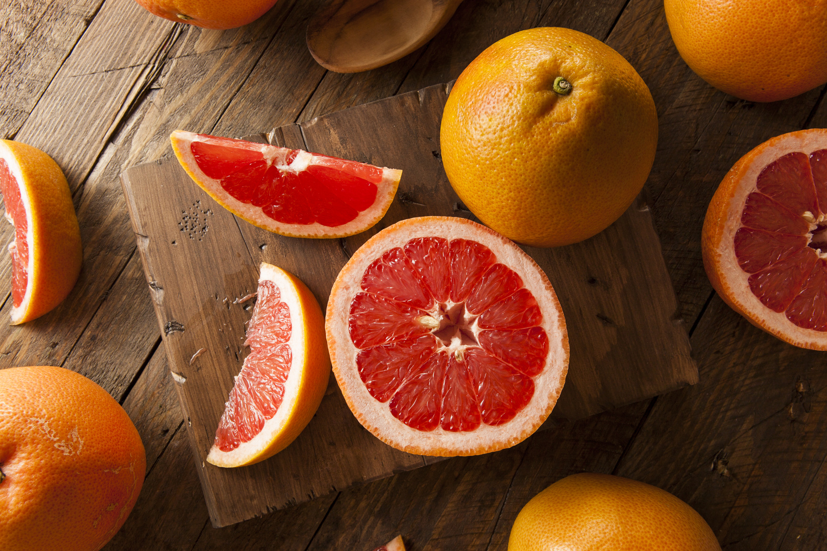 Healthy Organic Red Ruby Grapefruit on a Background