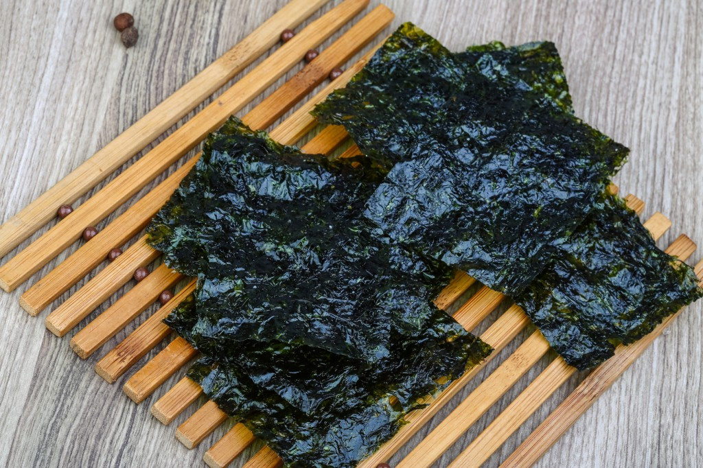 Korean traditional snack - Nori seaweed sheets on the wood background
